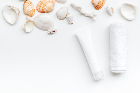 cosmetics with Dead Sea minerals and shells on white table background top view mockup Archivio Fotografico - 122962090