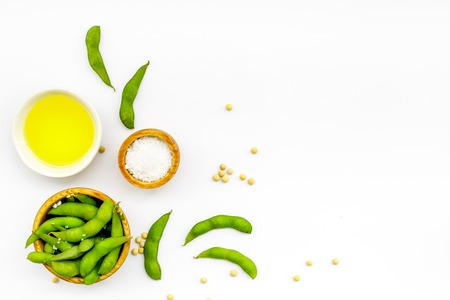 Sport diet food with green soybeans and oil background on white desk top view mockup
