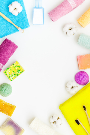 Soap, teeth brush, laundry powder. Products for laundry and wellness with cotton towels frame on white background top view copy space Stok Fotoğraf - 123152255