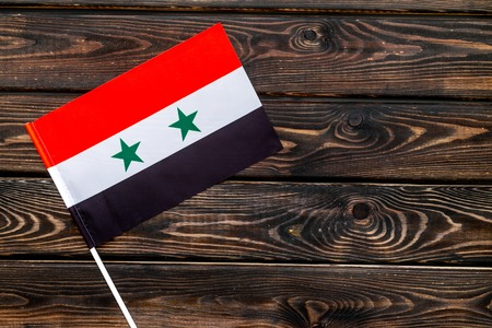 Independence Day of Syria concept with flag on wooden background top view.