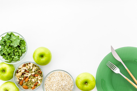 Proper nutrition. Medical starvation. Diet for weight loss concept with measuring tape, greenary and oat on white background top view copy space