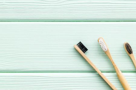 Zero waste lifestyle concept. Dental care with eco friendly bamboo tooth brush on mint green wooden background top view space for text Stock Photo - 123259994
