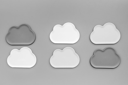 cloud computing concept with clouds on gray work desk background top view Фото со стока