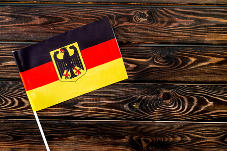 Symbol of the national day of German concept with flag on wooden background top view Фото со стока