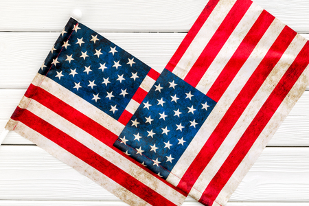 Symbol of Independence. USA national day background with flag on white wooden desk top view Фото со стока