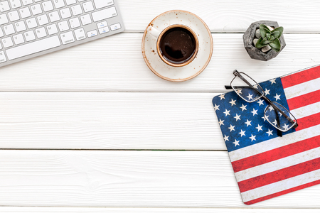 Symbol of Independence and Memoral day of United States of America with flag, keyboard, glasses and cup of coffee on white wooden background top view mockup Фото со стока