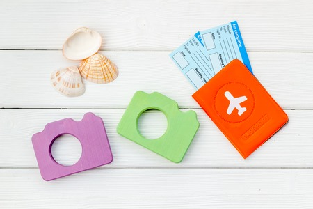 Travel bloger set. Camera, passport and tickets for summer photo at the seaside on white wooden background top view