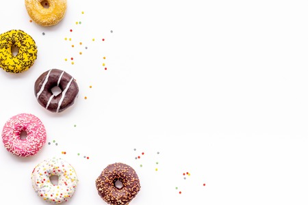 Sweet break concept. Traditional american donuts of different flavors on white background flat lay mockup