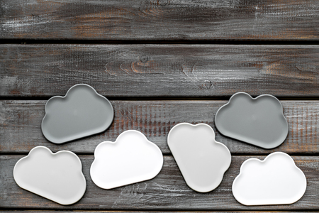 Cloud computing concept with clouds on wooden work desk background top view space for text