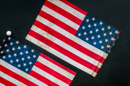 Symbol of Independence day of USA concept with flag on black background top view