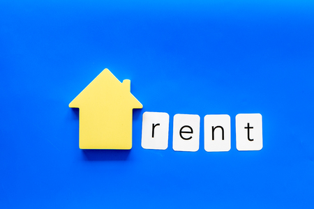 Rent house concept. Rent copy with house figure on yellow background top view