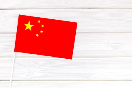 Flag of China on white wooden background top view. Imagens