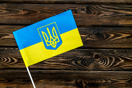 Independence Day of Ukraine concept with flag on wooden background top view.