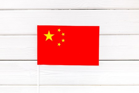 Flag of China on white wooden background top view. 版權商用圖片