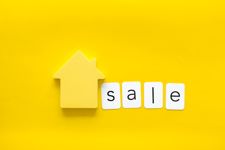 Buy house concept. Sale copy with house figure on yellow background top view
