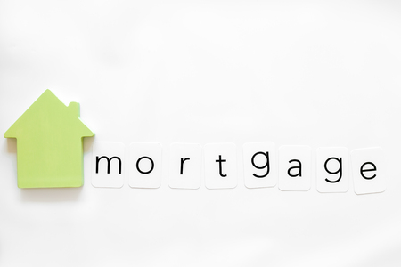 Mortgage credit concept. Insurance copy with house figure on white background top view Stock Photo