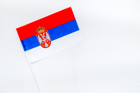 Flag of Serbia on white background top view.