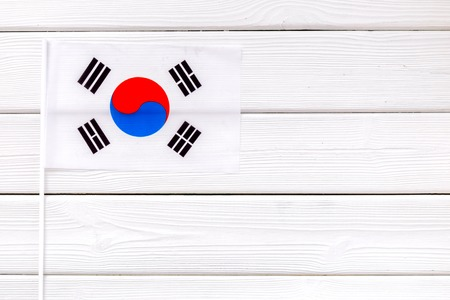 Flag of South Korea on white wooden background top view.