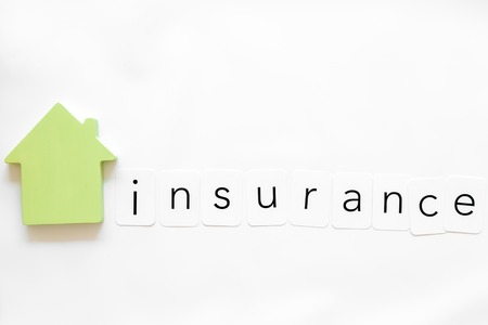Insurance copy with house figure on white background top view mock up