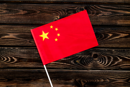 Flag of China on wooden background top view