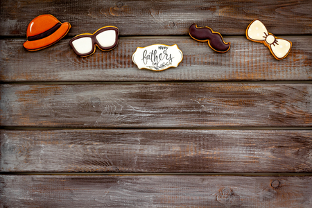 Happy Father Day with bow tie, moustache, glasses and hat cookies on white background top view mockup