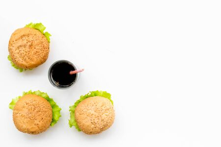 USA burgers and cola on white background top view copy space Reklamní fotografie