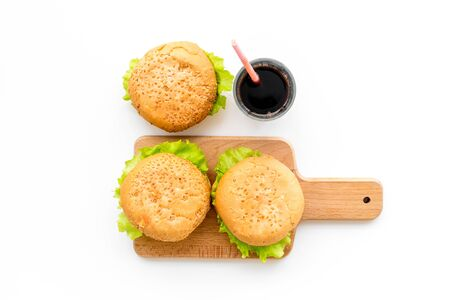 USA burgers and cola on white background top view Imagens