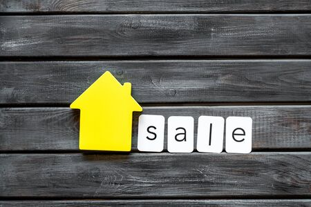 Buy house concept. Sale copy with house figure on wooden background top view Stock Photo
