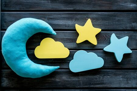 Good dream. Night sleep concept with moon, stars, cloud toy on wooden background top view 版權商用圖片