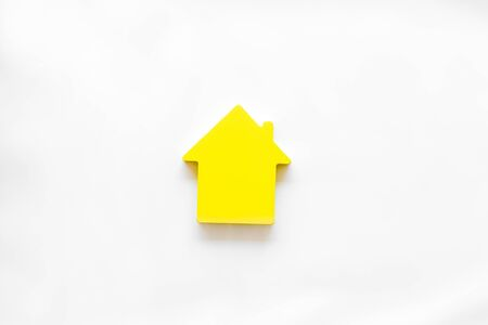 Purchasing a new property on credit. Mortgage credit concept with house toy on white background top view Stock Photo
