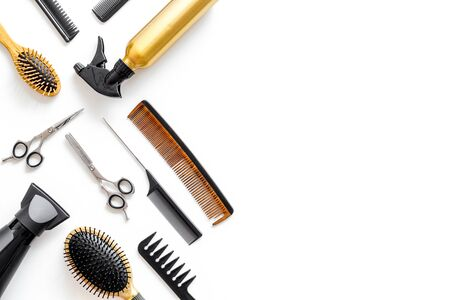 Hair styling concept. Combs, dryer and hairdresser tools on beauty salon work desk on white background top view mockup 写真素材