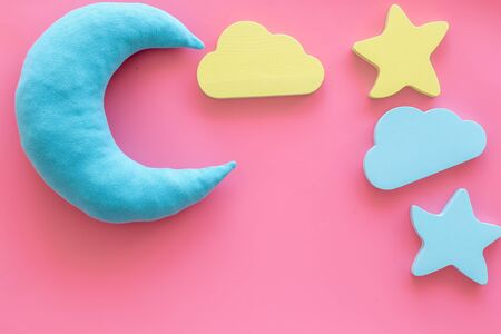 Good dream. Night sleep concept with moon, stars, cloud toy on pink background top view mock up