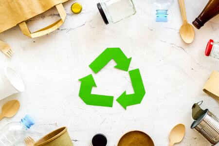 Recycling symbol and different garbage on marble background top view 版權商用圖片