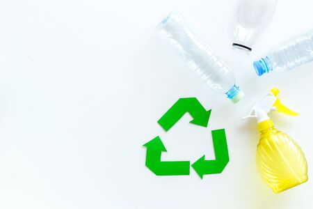 Recycling symbol and plastic bottles on white background top view copyspace 版權商用圖片
