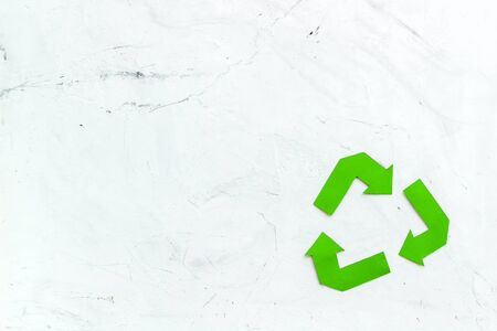 Recycling symbol for eco concept on white background top view copyspace