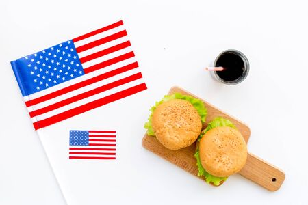 Flag USA and national food, burgers on white background top view
