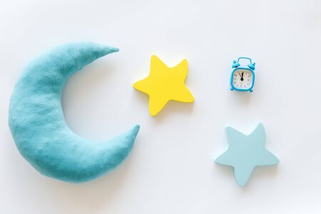 Sleep time concept with moon, stars, alarm clock on white background top view