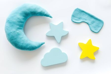 Good dream. Night sleep concept with moon, stars, clouds toy and mask on white background top view
