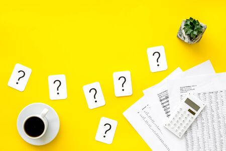 Business budget. Budget plan with calculator, coffee and question mark on yellow background top view