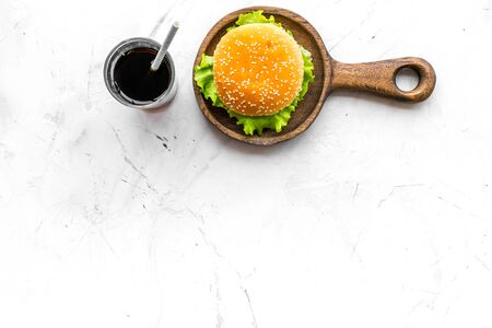 USA cuisine. Burger and drink for national american kitchen concept on marble background top view mock up Reklamní fotografie