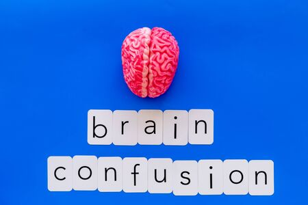 Mental diseases. Brain functions and brain confusion concept with brain on blue background top view