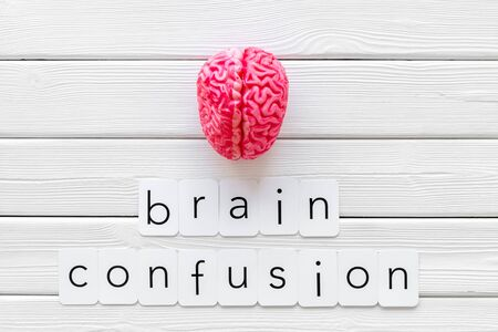 Mental diseases. Brain functions and brain confusion concept with brain on white wooden background top view