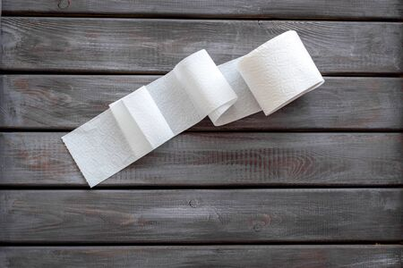 Disease of colon. Proctology concept with toilet paper on wooden background top view Stock Photo