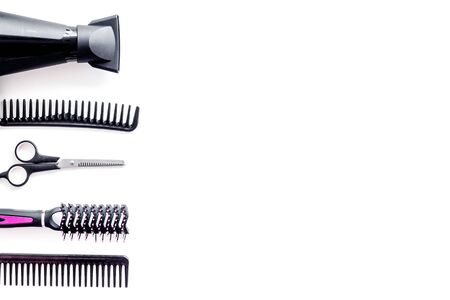 Set of professional hairdresser tools with combs, drier and scissors on white background top view mock up