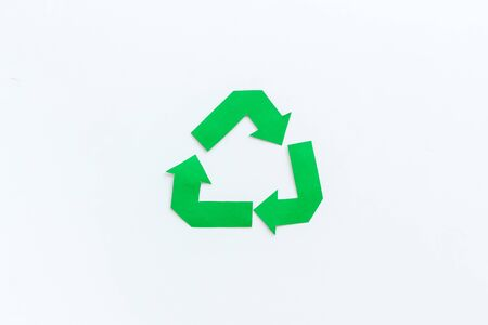Garbage disposal. Green recycling sign for eco concept on white background top view