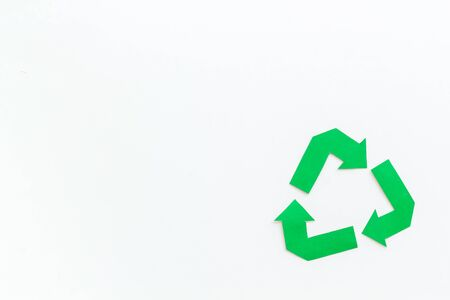 Green recycling symbol for ecology on white background top view mock up