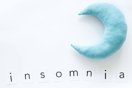 Go to bed. Sleep time concept with moon and insomnia copy on white background top view mockup