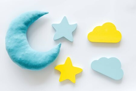 Insomnia concept. Night sleep concept with moon, stars, clouds toys on white background top view