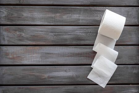 Disease of colon. Proctology concept with toilet paper on wooden background top view mock-up