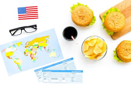 Traditional food. Burger, chips, map, tickets and USA flag for gastronomical tourism to America on white background top view Banque d'images - 126016111